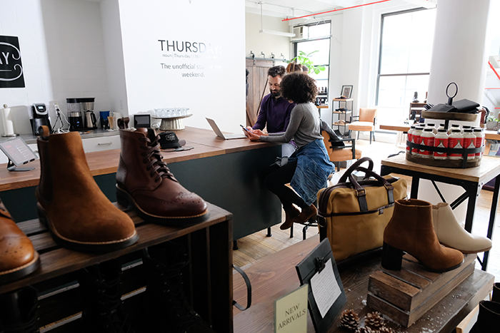NEW YORK, NY - FEBRUARY 06:  Thursday Boots Co-Founder Connor Wilson (L) speaks with an employee at Thursday Boots Company on February 6, 2018 in New York City.  (Photo by Matthew Eisman/Getty Images)